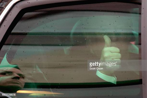President Donald Trump gives a thumbs up as he is driven down 15th Street during the Inaugural Parade on January 20 2017 in Washington DC Donald J...
