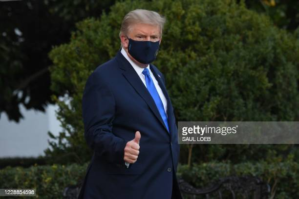 President Donald Trump gives a thumbs up as he walks to Marine One prior to departure from the South Lawn of the White House in Washington, DC,...