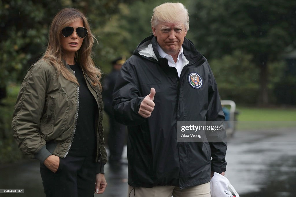 U.S. President Donald Trump gives a thumbs up as he walks with first lady Melania Trump prior to their Marine One departure from the White House August 29, 2017 in Washington, DC. President Trump was traveling to Texas to observe the Hurricane Harvey relief efforts.
