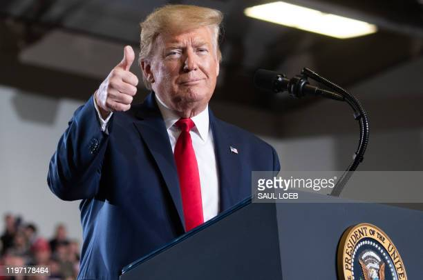 """President Donald Trump gives a thumbs up during a """"Keep America Great"""" campaign rally at Wildwoods Convention Center in Wildwood, New Jersey, January..."""