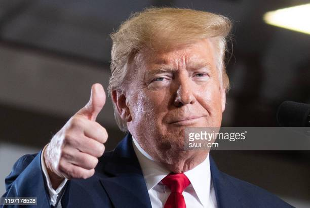US President Donald Trump gives a thumbs up during a Keep America Great campaign rally at Wildwoods Convention Center in Wildwood New Jersey January...
