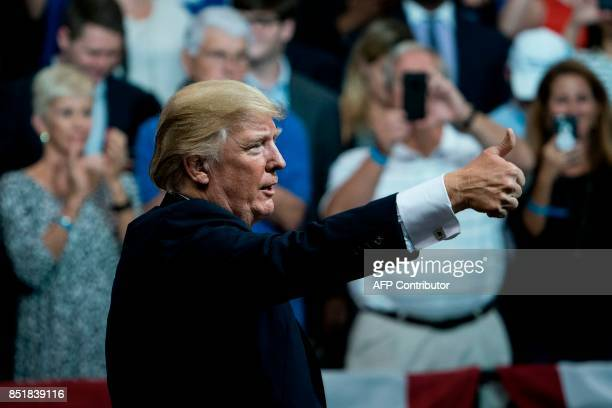 US President Donald Trump gives a thumbs up during rally for Alabama state Republican Senator Luther Strange at the Von Braun Civic Center September...