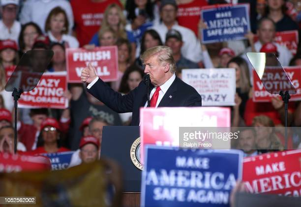 President Donald Trump gives a thumbs up to a crowd of supporters during a rally at the International Air Response facility on October 19 2018 in...