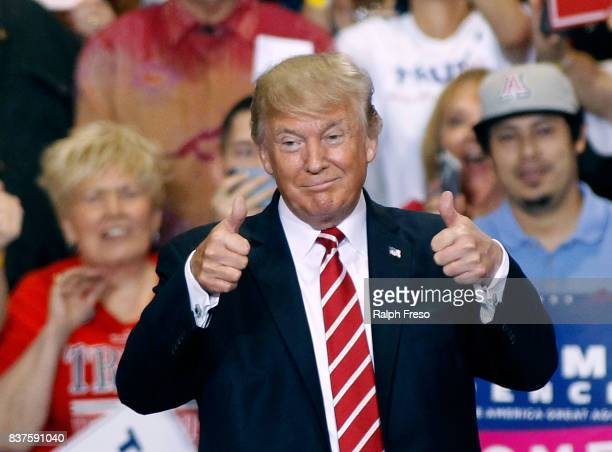 S President Donald Trump gives a thumbs up to supporters at the Phoenix Convention Center during a rally on August 22 2017 in Phoenix Arizona An...