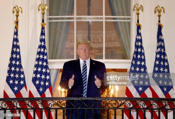 President Donald Trump gives a thumbs up upon returning to the White House from Walter Reed National Military Medical Center on October 05, 2020 in...