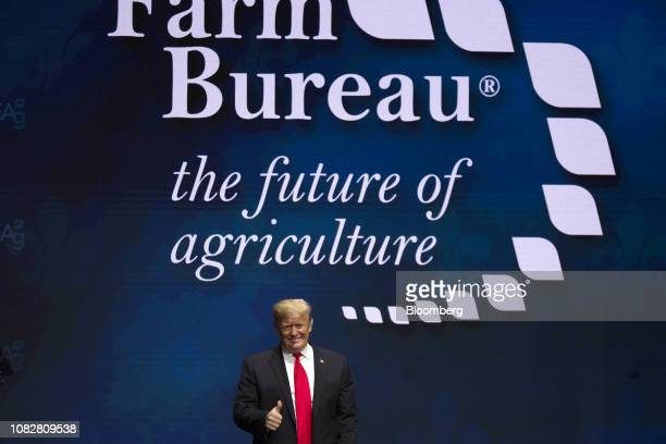 US President Donald Trump gives a thumbs up while arriving on stage during the 100th American Farm Bureau Federation Convention in New Orleans...