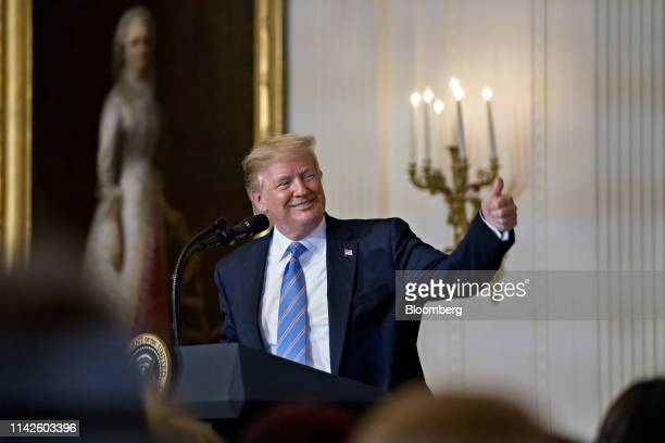 US President Donald Trump gives a thumbs up while speaking during a Celebration of Military Mothers event in the East Room of the White House in...