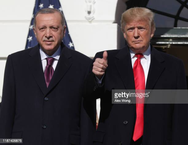 S President Donald Trump gives a thumbs up will greeting Turkish President Recep Tayyip Erdogan upon his arrival at the South Portico of the White...