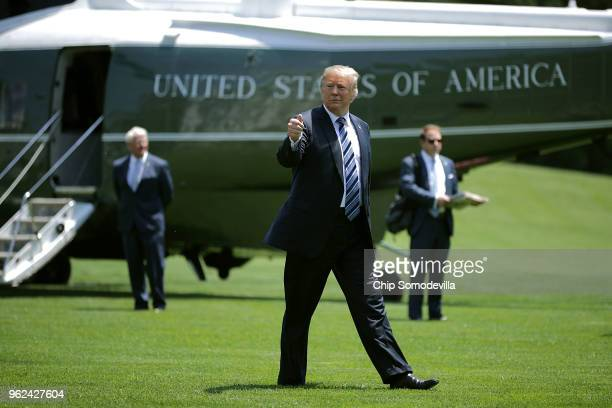 S President Donald Trump gives a thumbsup as he walks across the South Lawn after returning to the White House May 25 2018 in Washington DC Trump...