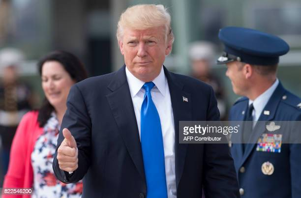 US President Donald Trump gives a thumbsup as he walks to Air Force One prior to departure from Andrews Air Force Base in Maryland July 25 en route...