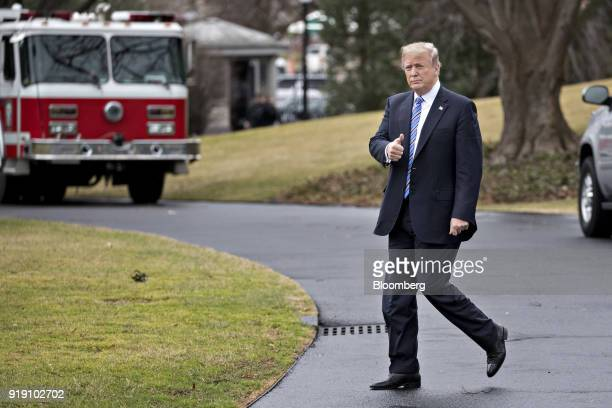 US President Donald Trump gives a thumbsup while walking on the South Lawn of the White House toward Marine One in Washington DC US on Friday Feb 16...