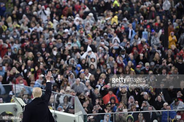 President Donald Trump gives his first speech after being swornin as the 45th US president in front of the Capitol in Washington on January 20 2017 /...