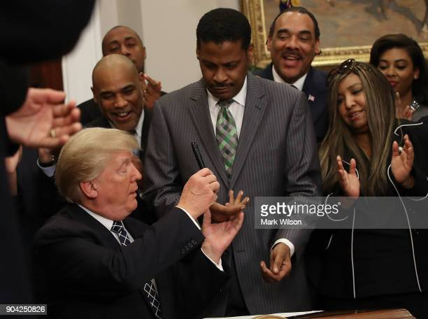 S President Donald Trump gives Isaac Newton Farris Jr the pen he used to sign a proclamation to honor Martin Luther King Jr day in the Roosevelt Room...