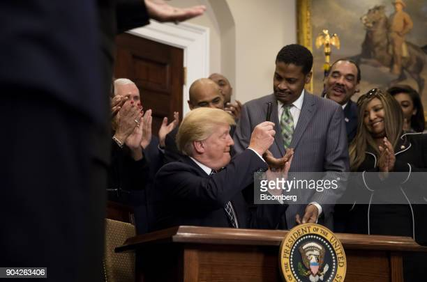 US President Donald Trump gives Martin Luther King Jr's nephew Isaac Newton Farris Jr chief executive officer of the Martin Luther King Jr Center for...