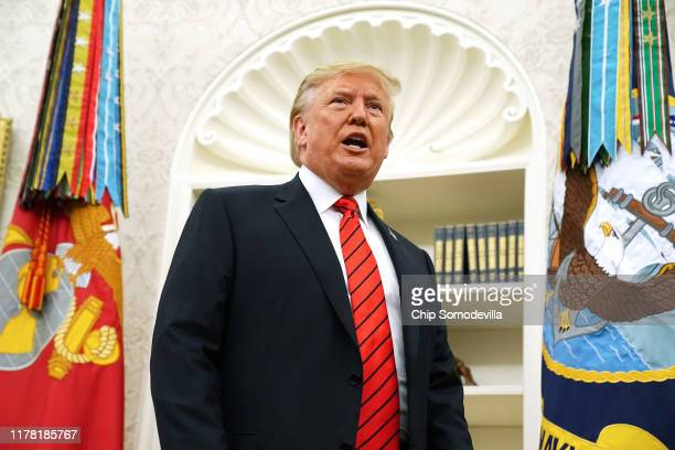 S President Donald Trump gives pauses to answer a reporters' question about a whistleblower as he leaves the Oval Office after hosting the ceremonial...