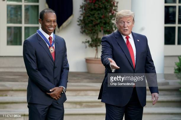 S President Donald Trump gives professional golfer and business partner Tiger Woods the Medal of Freedom during a ceremony in the Rose Garden at the...