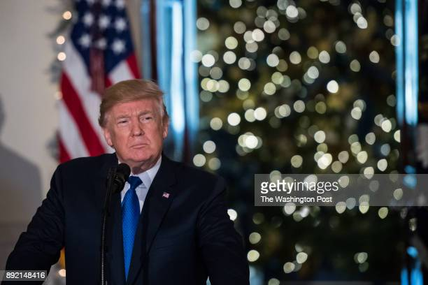 President Donald Trump gives remarks on tax reform at the Grand Foyer of the White House Wednesday Dec 13 in Washington