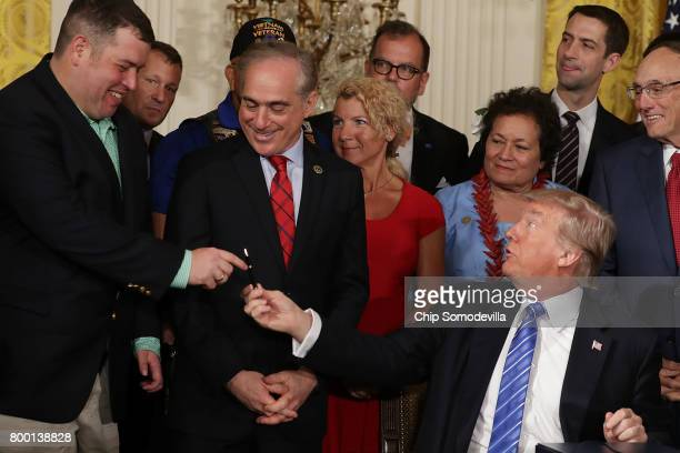 President Donald Trump gives the pen he signed the Department of Veterans Affairs Accountability and Whistleblower Protection Act of 2017 to...