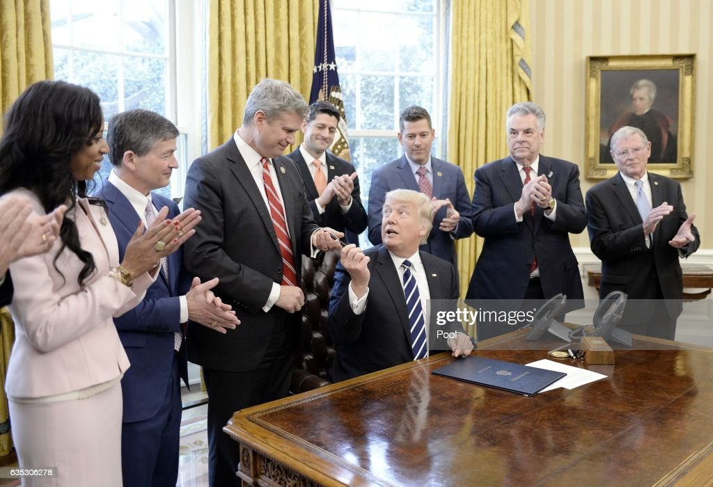 President Trump Signs A Resolution Related To Financial Reform : News Photo