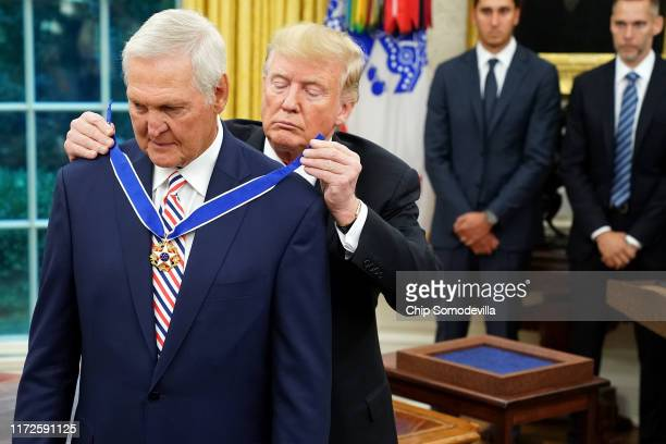 S President Donald Trump gives the Presidential Medal of Freedom to National Basket Ball Hall of Fame inductee Jerry West during a ceremony in the...