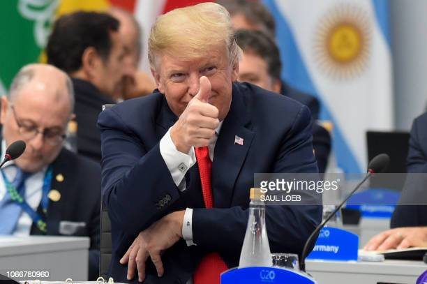 US President Donald Trump gives the thumb up during the G20 Leaders' Summit in Buenos Aires on November 30 2018 Global leaders gather in the...