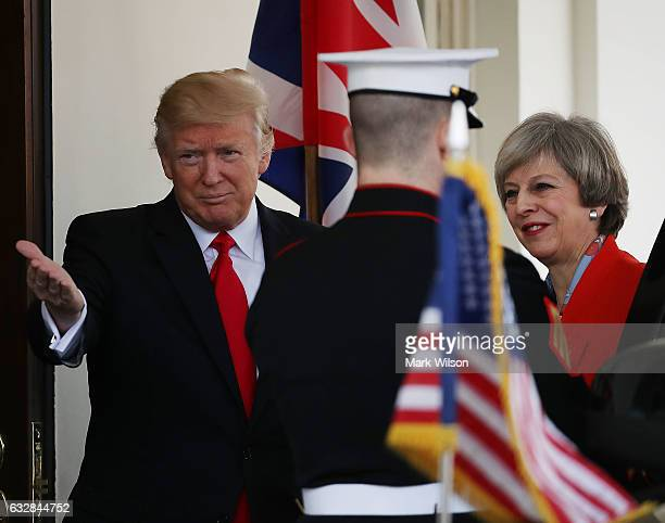 S President Donald Trump greets British Prime Minister Theresa May upon her arrival to the White House on January 27 2017 in Washington DC The two...