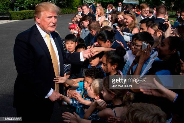 US President Donald Trump greets children of journalists and White House staff during Bring Our Daughters and Sons to Work Day at the White House in...