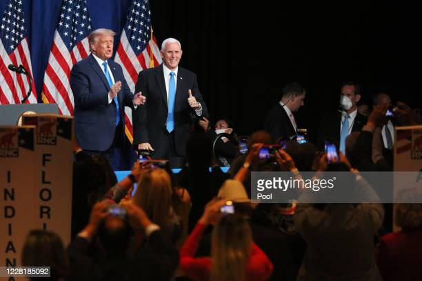 President Donald Trump greets delegates with Vice President Mike Pence on the first day of the Republican National Convention at the Charlotte...