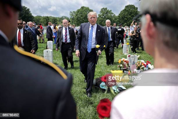 President Donald Trump greets families of the fallen in Section 60 at Arlington National Cemetery on Memorial Day May 29, 2017 in Arlington,...