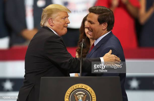 President Donald Trump greets Florida Republican gubernatorial candidate Ron DeSantis during a campaign rally at the Hertz Arena on October 31 2018...