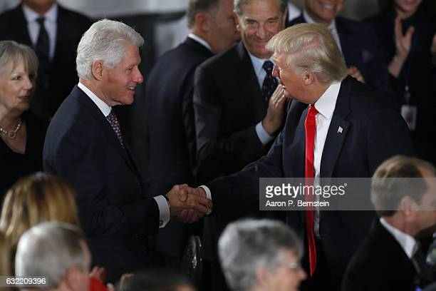 President Donald Trump greets former President Bill Clinton at the Inaugural Luncheon in the US Capitol January 20, 2017 in Washington, DC. President...