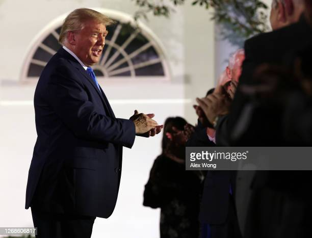 President Donald Trump greets guests ahead of first lady Melania Trump's address to the Republican National Convention from the Rose Garden at the...