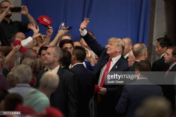 President Donald Trump greets guests as he leaves a rally where he was stumping for Troy Balderson on August 4 2018 in Lewis Center Ohio Balderson...