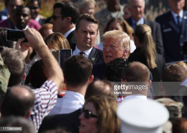 S President Donald Trump greets guests during a 911 memorial ceremony at the Pentagon to commemorate the anniversary of the 9/11 terror attacks...