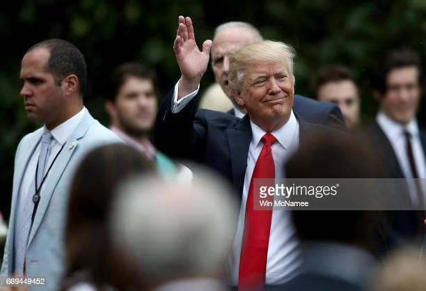S President Donald Trump greets guests during the 139th Easter Egg Roll on the South Lawn of the White House April 17 2017 in Washington DC The White...