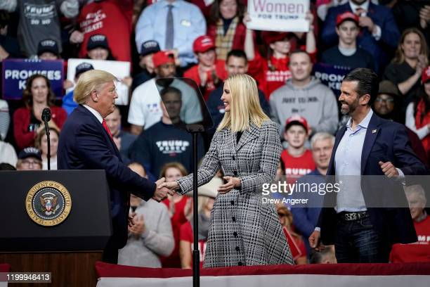 US President Donald Trump greets his daughter Ivanka Trump and son Donald Trump Jr during a Keep America Great rally at Southern New Hampshire...