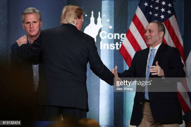 S President Donald Trump greets House Majority Leader Rep Kevin McCarthy and House Majority Whip Rep Steve Scalise during a lunch at the 2018 House...