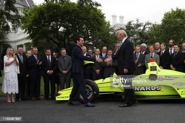 S President Donald Trump greets Indianapolis 500 winner Simon Pagenaud during a ceremony to honor the driver at the White House on June 10 2019 in...