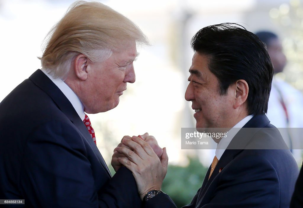 President Donald Trump (L) greets Japanese Prime Minister Shinzo Abe as he arrives at the White House on February 10, 2017 in Washington, DC. The two will hold a bilateral meeting and press conference today at the White House.