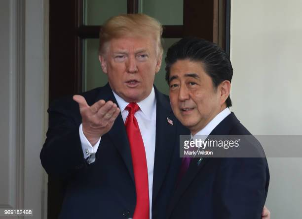S President Donald Trump greets Japanese Prime Minister Shinzo Abe at the West Wing of the White House on June 7 2018 in Washington DC The two...