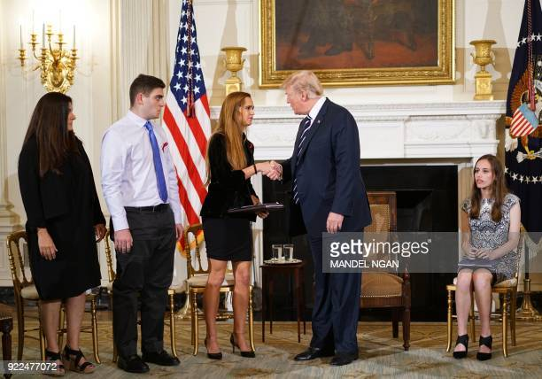 US President Donald Trump greets Julia Cordover Parkland Student body president as he arrives for a listening session on gun violence with teachers...