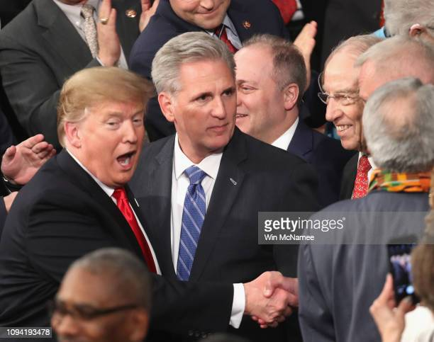 President Donald Trump greets lawmakers ahead of the State of the Union address in the chamber of the U.S. House of Representatives at the U.S....