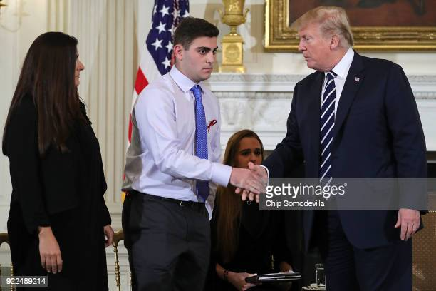 US President Donald Trump greets Marjory Stoneman Douglas High School shooting survivor Jonathan Blank and his mother Melissa Blank before hosting a...