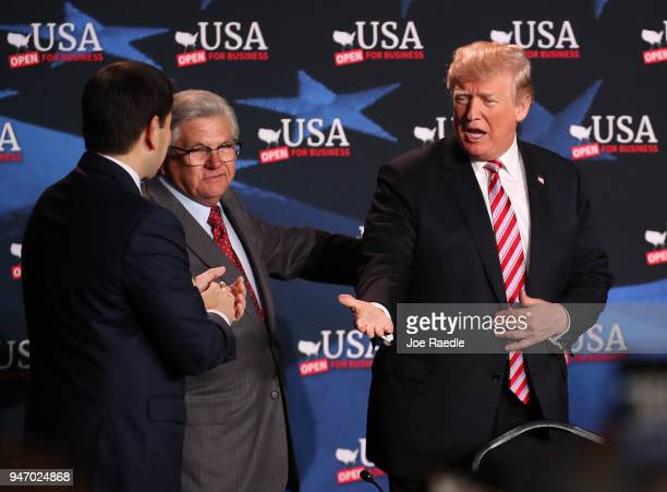 S President Donald Trump greets Maximo Alvarez and Sen Marco Rubio as he arrives for a roundtable discussion about the Republican $15 trillion tax...