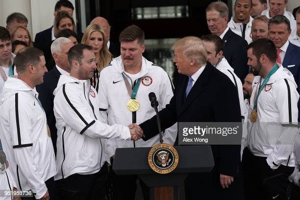 S President Donald Trump greets members of the men's curling team John Shuster Tyler George and Matt Hamilton as he hosts Team USA at the North...