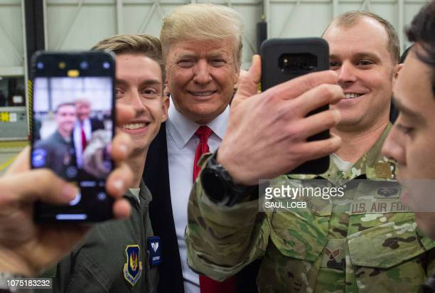 President Donald Trump greets members of the US military during a stop at Ramstein Air Base in Germany on December 27 2018 President Donald Trump...
