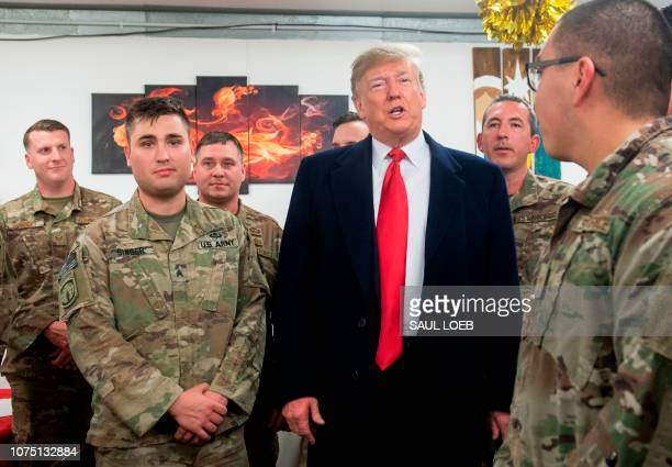 President Donald Trump greets members of the US military during an unannounced trip to Al Asad Air Base in Iraq on December 26, 2018.
