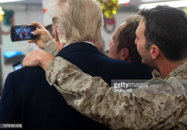 President Donald Trump greets members of the US military during an unannounced trip to Al Asad Air Base in Iraq on December 26 2018 President Donald...