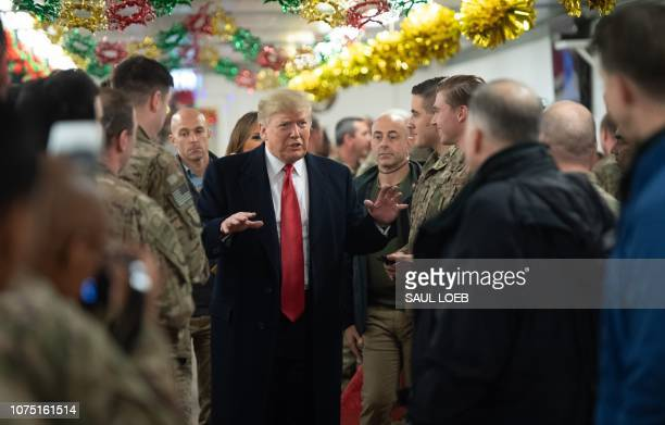 US President Donald Trump greets members of the US military during an unannounced trip to Al Asad Air Base in Iraq on December 26 2018 President...