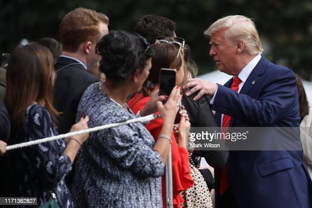 S President Donald Trump greets onlookers as he returns to the White House after attending the United Nations General Assembly on September 26 2019...